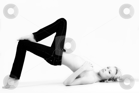 Young woman in jeans in a creative pose stock photo, Studio portrait of a blond woman in only jeans by Frenk and Danielle Kaufmann