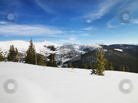 Mountain snowy landscape. stock photo, Snow covered mountain landscape. by Iofoto Images
