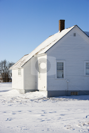 Rural house in snow. stock photo, Rural house in snow. by Iofoto Images