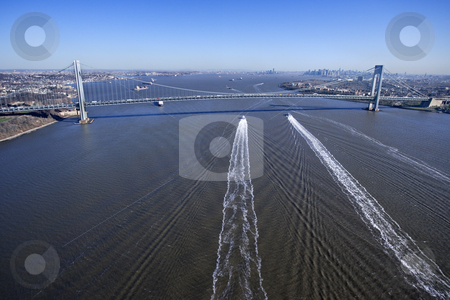 Manhattan bridge, NYC. stock photo, Aerial view of New York City's Verrazano-Narrow's Bridge with boats in water. by Iofoto Images