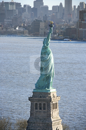 Statue of Liberty. stock photo, Aerial view of Statue of Liberty with Manhattan, New York buildings in background. by Iofoto Images