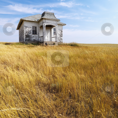Old abandoned house. stock photo, Weathered abandoned building in remote grassland. by Iofoto Images
