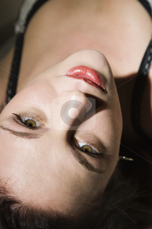 Sexy woman. stock photo, Sexy Caucasian woman lying down looking up at viewer. by Iofoto Images