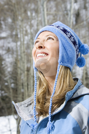 Attractive  woman. stock photo, Head and shoulder view of attractive smiling mid adult Caucasian blond woman wearing blue ski clothing. by Iofoto Images