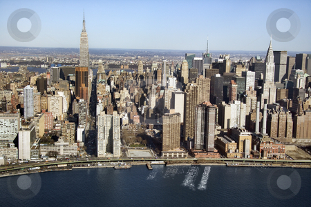 Manhattan, NYC. stock photo, Aerial view of Manhattan and East River in New York City. by Iofoto Images