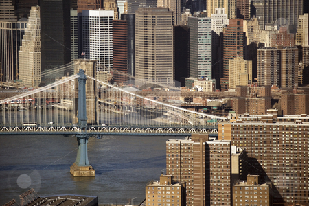 Manhattan Bridge, NYC. stock photo, Aerial view of New York City's Manhattan Bridge with Brooklyn Bridge and Manhattan buildings in background. by Iofoto Images