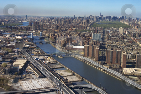 Harlem River and Bronx. stock photo, Aerial view of Harlem River and bridges with the Bronx and Manhattan buildings in New York City. by Iofoto Images