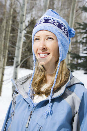 Smiling woman. stock photo, Attractive smiling mid adult Caucasian blond woman wearing blue ski clothing. by Iofoto Images