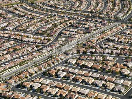 Urban housing sprawl. stock photo, Aerial view of suburban neighborhood urban sprawl in Las Vegas, Nevada. by Iofoto Images