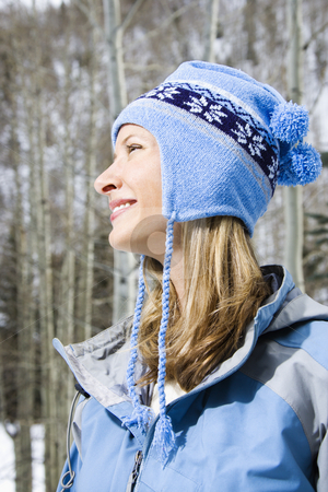 Attractive  woman. stock photo, Side view head and shoulder of attractive smiling mid adult Caucasian blond woman wearing blue ski clothing. by Iofoto Images