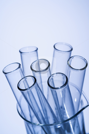 Laboratory equipment stock photo, Test tubes in glass beaker with blue tint. by Iofoto Images