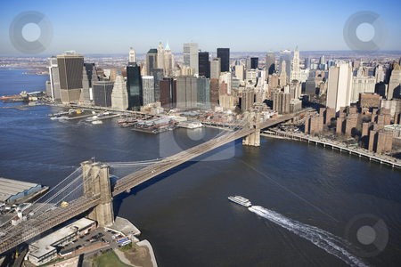 Brooklyn Bridge, NYC. stock photo, Aerial view of in New York City with  Brooklyn Bridge and Manhattan skyline with ferry boat. by Iofoto Images