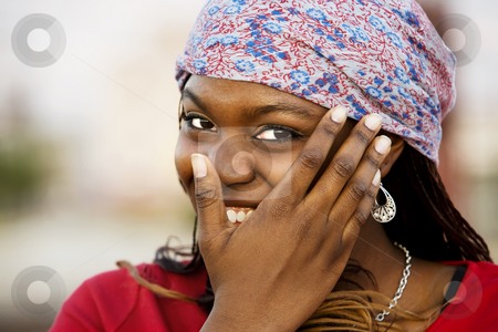 Pretty woman stock photo, Closeup of a pretty African American woman with a scarf by Scott Griessel