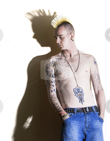 Punk with tattoos stock photo, Punk with tattoos leaning against a white wall by Scott Griessel