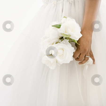 Bride holding bouquet. stock photo, African-American bride holding bouquet. by Iofoto Images