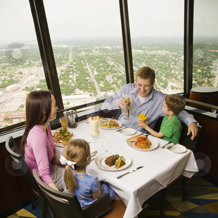 Family dinner. stock photo, Caucasian family having dinner together at Tower of Americas restaurant in San Antonio, Texas. by Iofoto Images