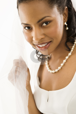 Bridal portrait. stock photo, Portrait of a mid-adult African-American bride on white background. by Iofoto Images