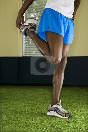 Male stretching. stock photo, African-American male stretching. by Iofoto Images