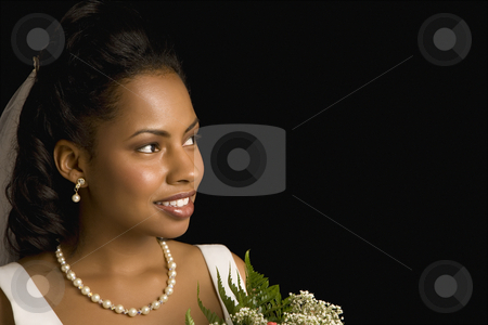 Bridal portrait. stock photo, Portrait of a mid-adult African-American bride holding bouquet. by Iofoto Images