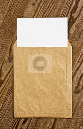 Brown Vintage Envelope. stock photo, Open Brown Vintage Envelope, with white paper, over wooden surface. by Pablo Caridad