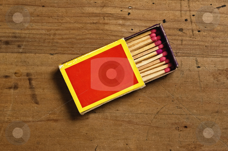 Matchbox on old table. stock photo, Matchbox on old table. by Pablo Caridad