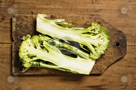 Broccoli. stock photo, Broccoli on wooden table. by Pablo Caridad