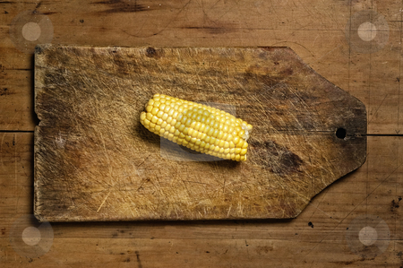 Fresh corn. stock photo, Fresh corn on old wooden table. by Pablo Caridad