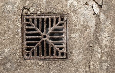 Rusty drain grate. stock photo, Close up shot of a rusty drain grate. by Pablo Caridad