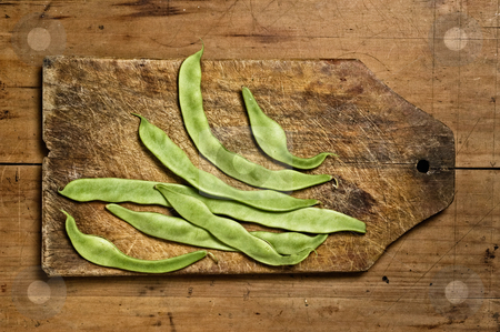 Green beans on wooden table. stock photo, Green beans on wooden table. by Pablo Caridad