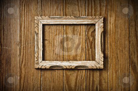 Vintage picture frame stock photo, Blank vintage picture frame on a wooden wall. by Pablo Caridad