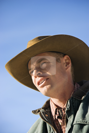 Portrait of cowboy. stock photo, Middle-aged Caucasian male wearing a cowboy hat. by Iofoto Images