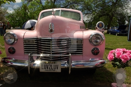 Luv my pink Cadillac stock photo, This vintage pink 1941 Cadillac is reportedly painted an Elvis shade of pink.  The custom Caddy won several  awards at the 2008 Pequot Lakes, MN car show (photo June, 2008). by Dennis Thomsen