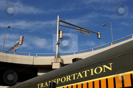 Transportation stock photo, Trailcar in the foreground and a concrete highway overpass in the background provide an interesting message about transportation and travel. by Dennis Thomsen