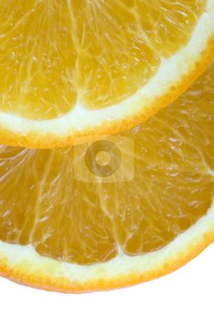 Orange slices stock photo, Two slices of orange on a white backdrop by Stephen Gibson