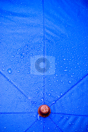 Wet umbrella stock photo, A closeup of a wet blue unmbrella by Vince Clements