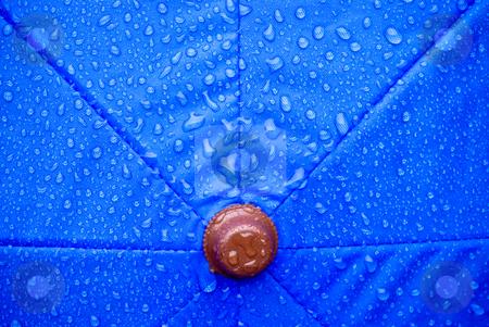 Wet umbrella stock photo, A closeup of a wet blue unmbrella by Vince Clements