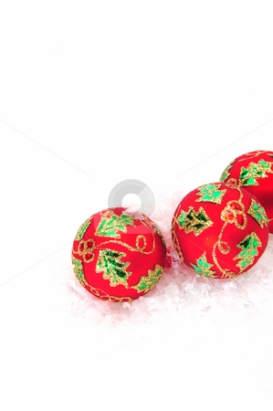 Red Christmas Decorations stock photo, Red christmas tree ornaments with green and gold detail. by Lynn Bendickson