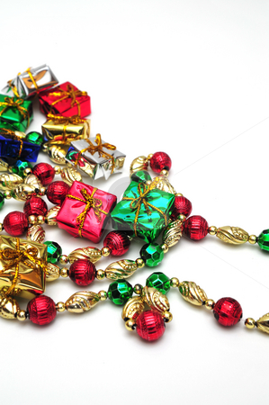 Christmas Gifts And Beads stock photo, A strand of decorative beads for a christmas tree by Lynn Bendickson