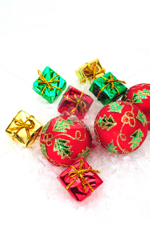 Small Gifts And Ornaments stock photo, Red christmas tree ornaments and small colorful gifts by Lynn Bendickson