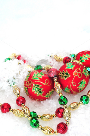 Christmas Tree Beads And Ornaments stock photo, Christmas tree decorations on a white snowy background by Lynn Bendickson
