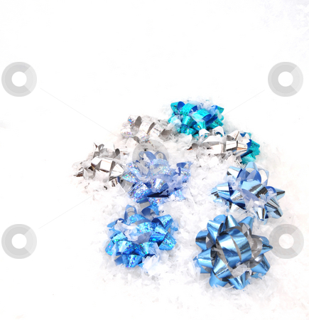 Christmas Bows And Snow stock photo, Different shades of blue christmas bows in snow by Lynn Bendickson