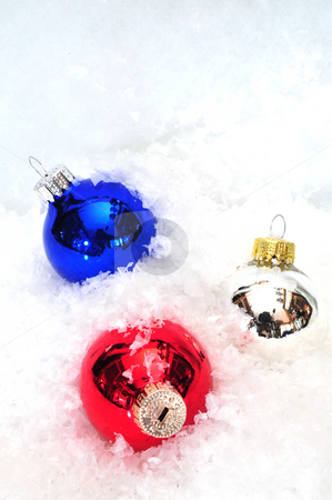 Christams Ornamnts And Snow stock photo, Red, Blue and Silver christmas decroations by Lynn Bendickson