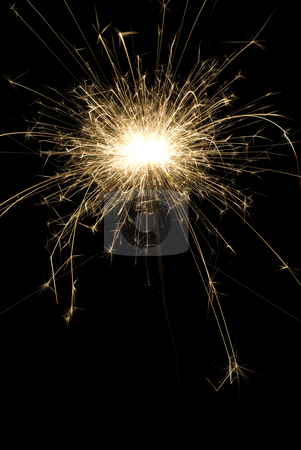 Sparkler stock photo, A burning party sparkler shot at night by Richard Nelson