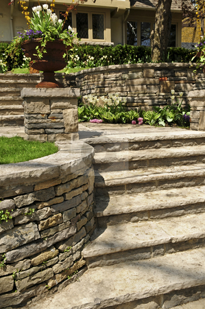 Natural stone landscaping stock photo, Natural stone landscaping in front of a house by Elena Elisseeva