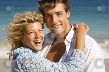 Happy smiling couple. stock photo, Happy smiling couple embracing on Maui, Hawaii beach. by Iofoto Images
