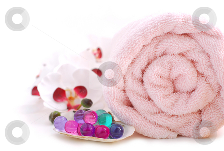 Spa stock photo, Pink rolled up towel with bath beads on white background by Elena Elisseeva