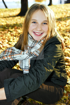 Teenage girl in the fall stock photo, Portrait of a beautiful teenage girl in fall park by Elena Elisseeva