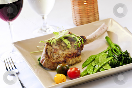 Veal dinner stock photo, Gourmet dinner of veal rib chop and vegetables by Elena Elisseeva