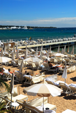 Beach in Cannes stock photo, View on the beach from Croisette promenade in Cannes, France by Elena Elisseeva