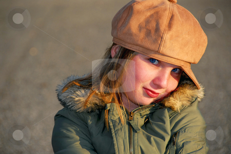 Girl winter hat stock photo, Portriat of a coy smiling girl in winter or fall clothes outside by Elena Elisseeva